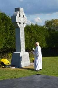 FR. MCCORMICK blessed the Celtic cross along with the triple cenotaph during the ceremony.