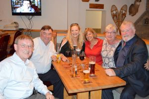 LARRY BRADLEY (far right) of the Heart and Crown Irish Pubs in Ottawa with his guests. Larry sponsored the reception at Brennan's Hill Inn.